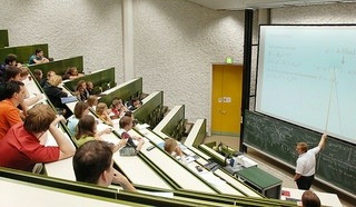 students sitting in a large lecture hall